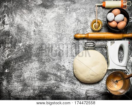Dough Background. The Dough With The Mixer And Various Ingredients .