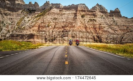 Two motorcyclists riding on a South Dakota highway.