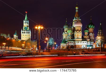 church and towers of Kremlin at night. view from Novokuznetsk bridge. Tracers from cars.