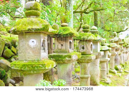 Old stone lanterns in Nara Japan. Selective focus.
