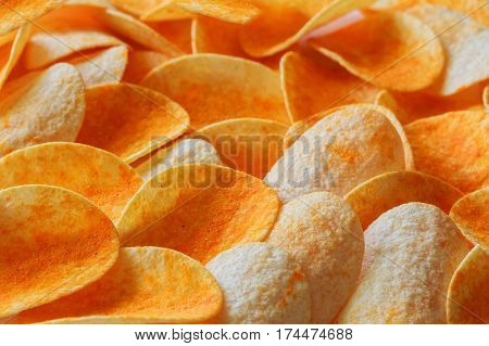 Rippled fresh organic potato chips background. Potato chips background