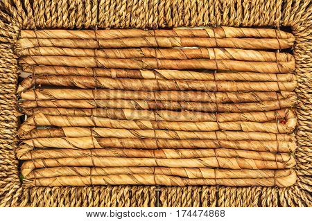 Textures and patterns close up concept. Detailed closeup of brown wicker texture pattern