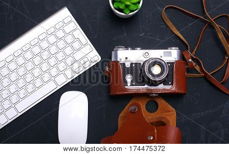 Top view of office graphic design pen mouse with laptop wireless mouse and vintage old camera on table. Concept graphic design workplace.