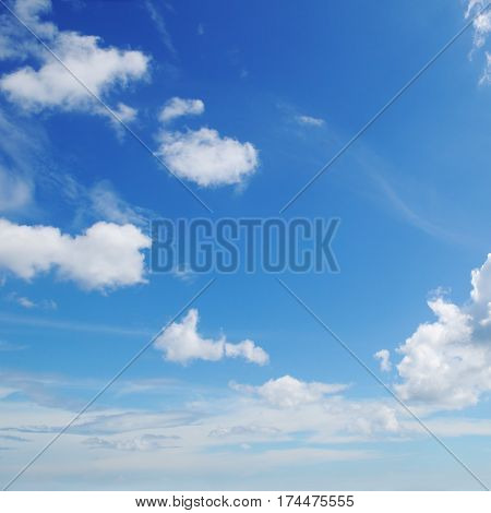 A blue sky and white cumulus clouds