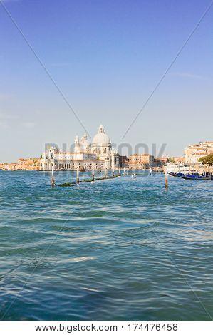 Basilica Santa Maria della Salute and Grand canal water, sunny day in Venice, Italy