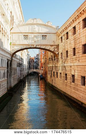 Bridge of Sighs over canal, sunny day in Venice, Italy