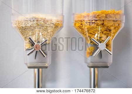 Cereal and cornflakes dispensers  on a self service breakfast in a hostel