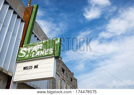 Carthage Missouri USA - July 6 2014: Star Lane Bowling Alley sign against a blue sky in the city of Carthage Missouri