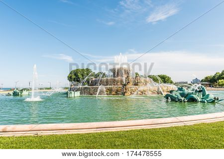 Chicago USA - May 30 2016: Buckingham Memorial Fountains in Grant Park in Illinois with people walking on a hot summer day with skycrapers