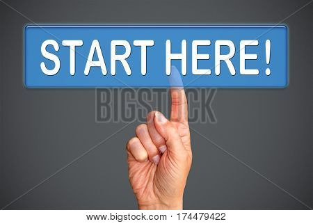 Start here - female hand with internet touchscreen button