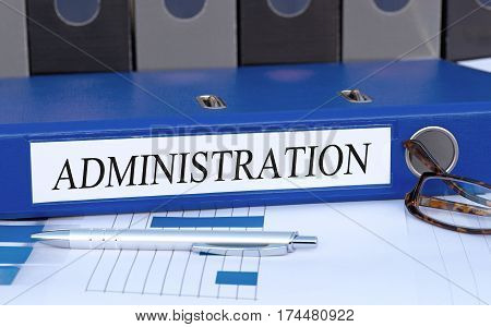 Administration - blue binder on desk in the office