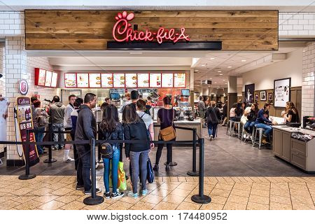 Fairfax USA - February 18 2017: Chick-fil-a store with people in line waiting to buy food