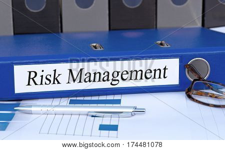 Risk Management - blue binder on desk in the office