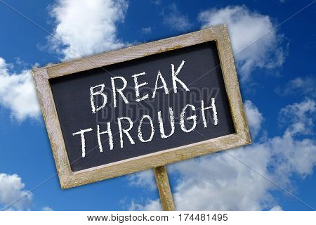 Break Through - chalkboard with text and blue sky in the background