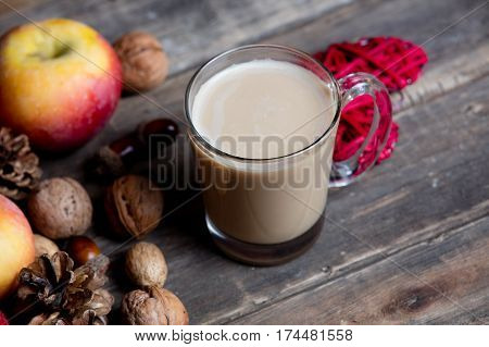 Cup Of Coffee, Heart Shaped Toy, Nuts, Cones And Apples On The Wonderful Brown Wooden Background