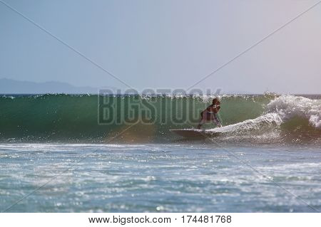 Man Surfing On Pacific Ocean Wave