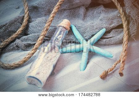 Beautiful Souvenir, Starfish, Rope And Cool Fishnet Lying On The Wonderful Beach Sand Background
