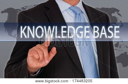 Knowledge Base - Businessman with touchscreen and text