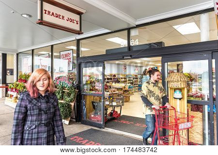 Fairfax USA - November 25 2016: People walking at Trader Joes grocery store by entrance