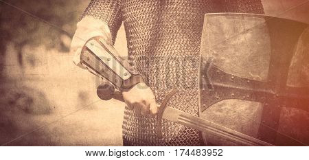 Strong Knight Hand With Beautiful Sword And Shield On The Middle Ages Decoration Background