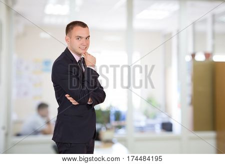 One Man in Business Style Clothing dark blue jacket and tie on staying at Office Room Interior thinking Face Expression