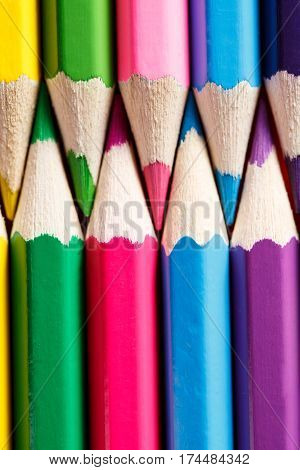 Different colored crayon opposed each other. Direct position of pencils. Art and design. Artist. DRawing and painting. School and education.