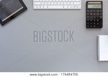 Top View of working Place on grey wooden Desk in classic tones with Computer Keyboard and other Business Items