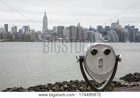 Binoculars And New York City Manhattan Skyline
