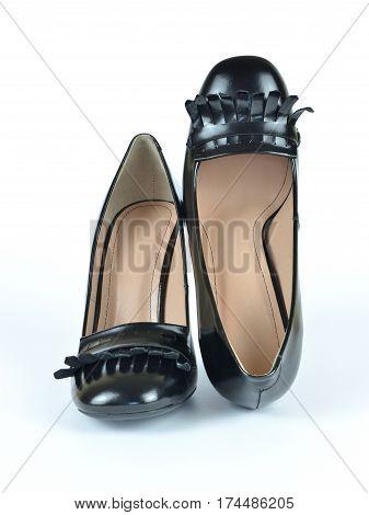 Black elegant shiny leather high heel loafer shoes on white