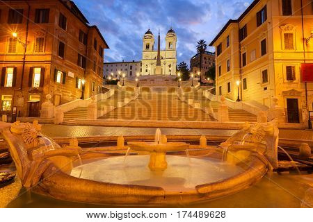 famous Spanish Steps with boat fountain illuminated at blue night, Rome, Italy