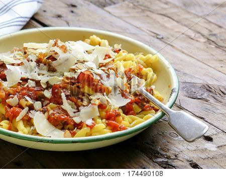Italian Pasta With Tomato Sauce, Smoked Pancetta, Roasted Almonds And Parmesan Cheese