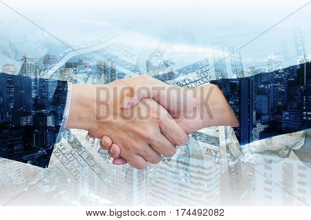 Double Exposure Of Businessman And Businesswoman Handshake With City Of Business In Blue Tone Backgr