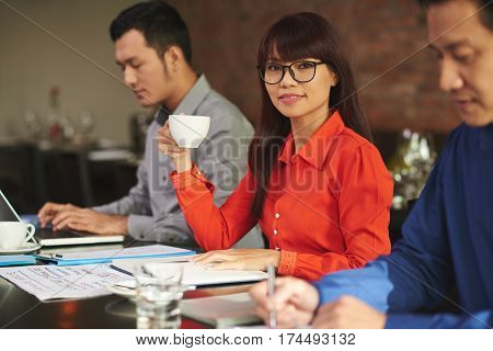 Beautiful Asian business lady with a cup of coffee