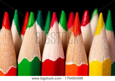 colered crayon , pencil macro shoot against a dark background. Pencils stand. Art and design. Artist. School and education. Hobbi. Close-up.