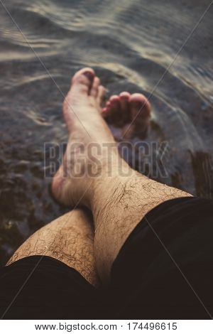 Soak your feet in river on happy time