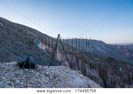 Tripod is ready to shoot photography. Mountains of Altiplano Bolivia South America.