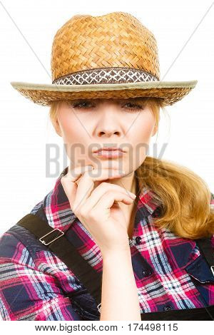 Thinking Woman Wearing Sun Hat And Dungarees