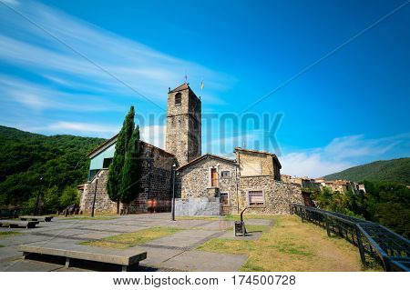 Castellfollit de la Roca, a municipality in the comarca of Garrotxa, Province of Girona, Catalonia, Spain. The basalt crag where the town is situated is over 50m high and almost a kilometre long.