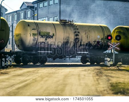 The train with gasoline tank goes by the rail