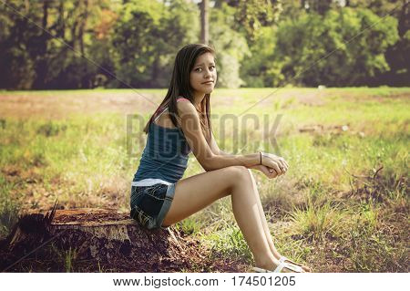 Girl alone thinking in a park in Houston Texas