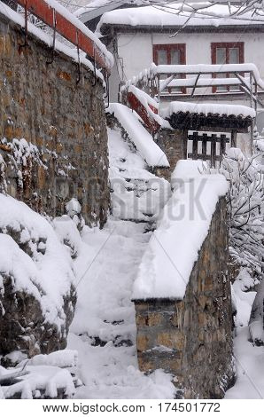 Snowy stone staircase in the winter in Bulgaria