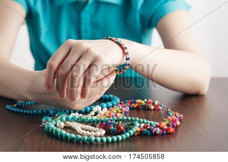Girl Puts Bracelet On His Hand And A Bunch Of Jewelry