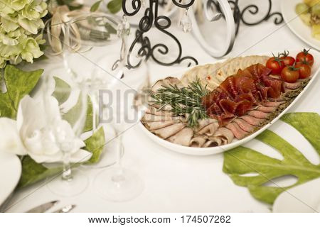 Serving dinner wedding feast. Beautifully designed décor and delicious food. Wedding table