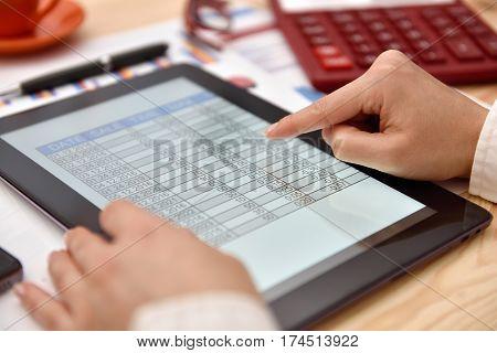 Businesswoman Hand Analyzing Income Data