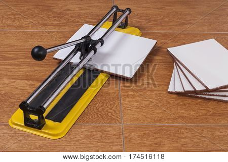 Tile Cutter On The Floor