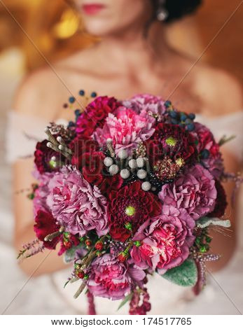 beautiful bride with a bouquet of purple flowers at the wedding