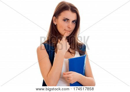 beautiful young girl in white shirt and with a portfolio and balked at holding a blue folder isolated on white background