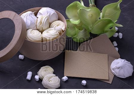 Bouquet Of Green Yellow Callas With Marshmallows In A Wooden Round Box On A Gray Wooden Background.