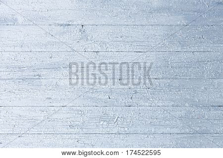 Wooden silver Vintage Style Texture. Rustic Old Cracked Wood Board Wall Shabby Grey Color Background. Surface Panel with Peeling Paint Close up. Horizontal Image Copy Space.