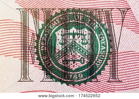 Stamp of the Department of The Treasury on US fifty dollar bill closeup macro.